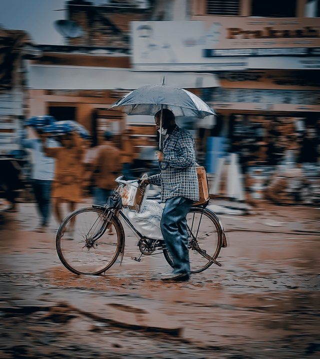 A cyclist in a market place