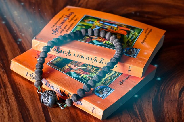 An old bead necklace on a sacred books