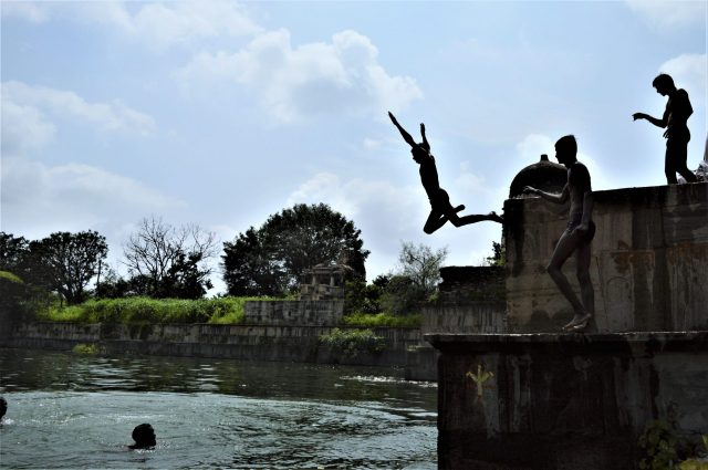 people diving in pond