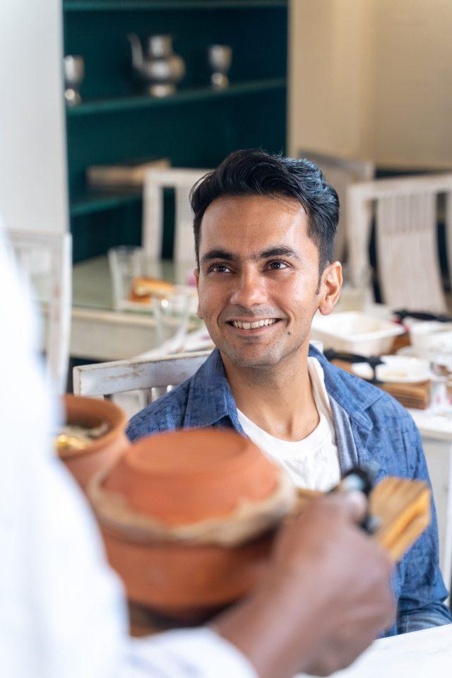 Man smiling after seeing food