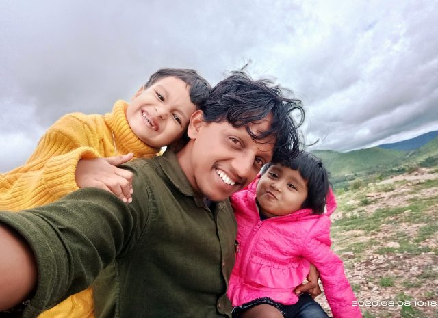 Man taking selfie with his daughters