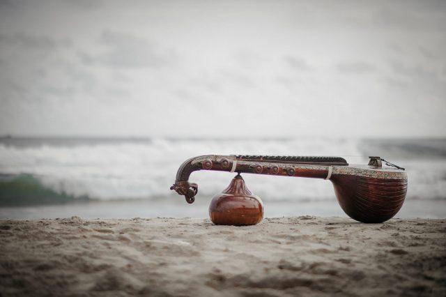 Musical Instrument Veena on a beach