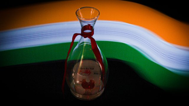 Tricolor behind a flask