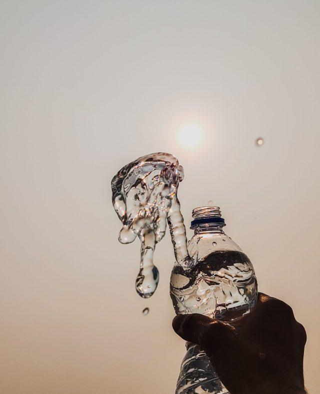 water splashing out of bottle
