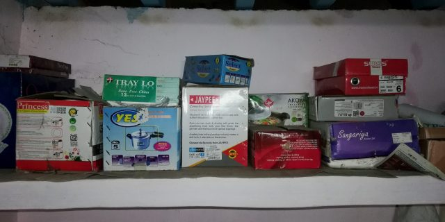 Different product boxes in a shelf