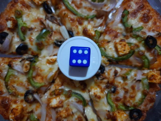 A dice on pizza