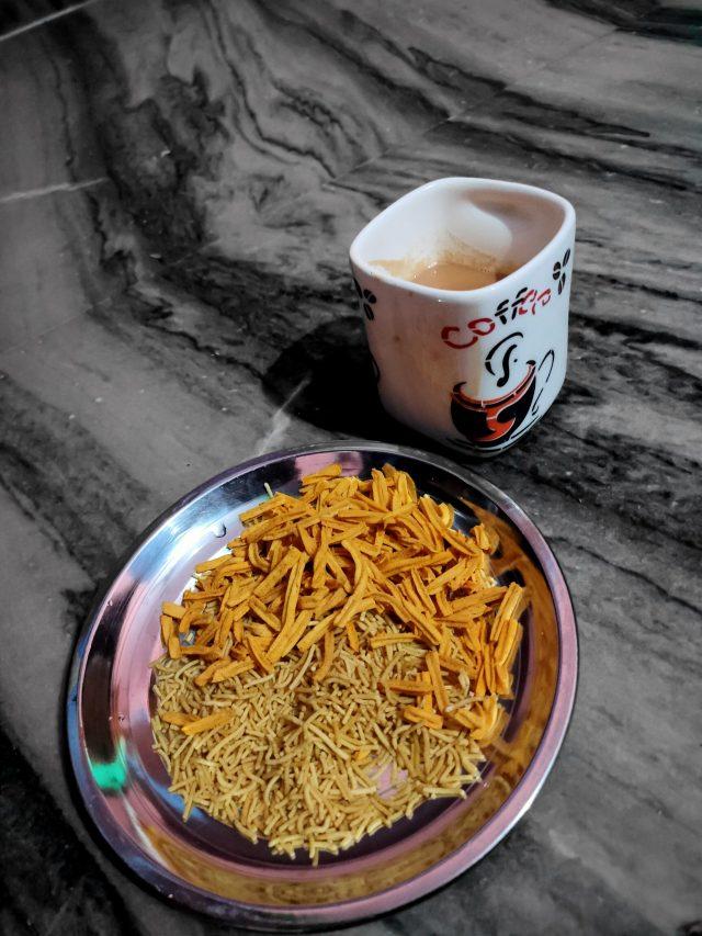 A teacup and snacks