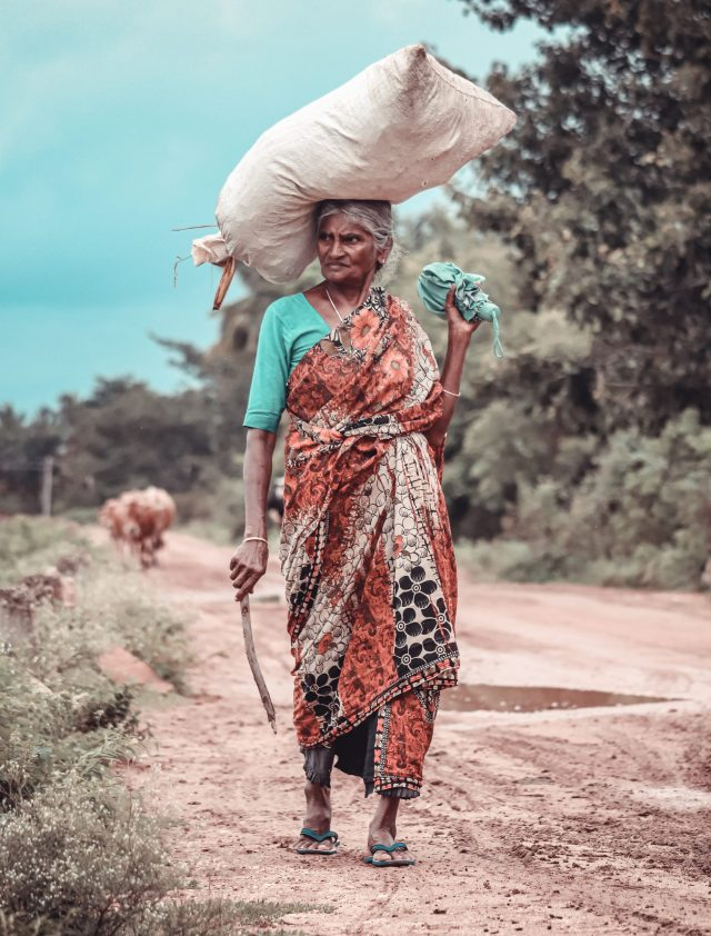 A village woman carrying a sack