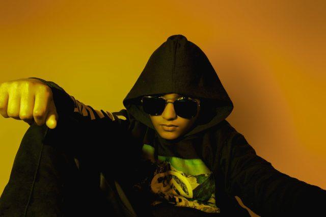 Boy posing wearing hoodie