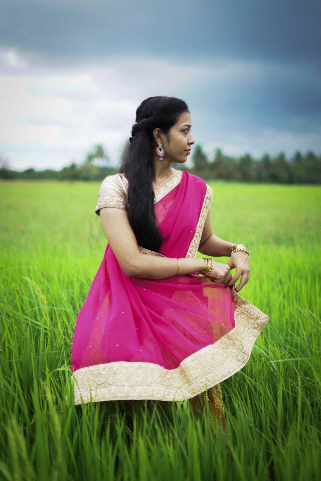 Girl poising in crop farm