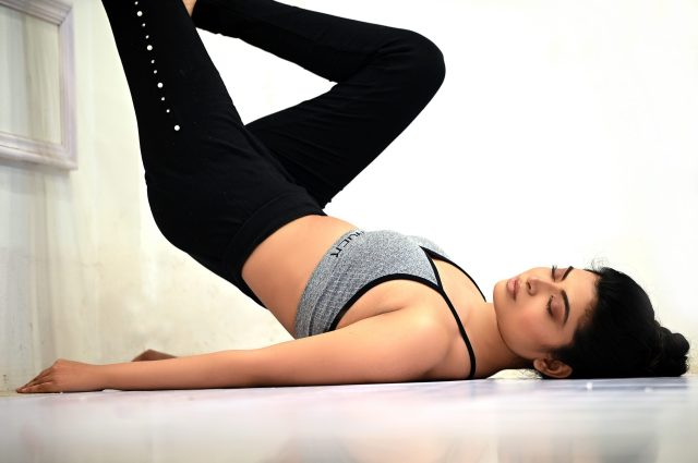 Girl stretching while closing her eyes