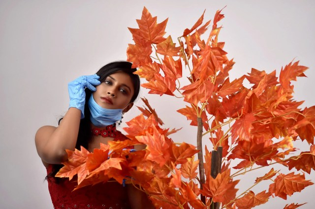 Girl wearing mask near the plant