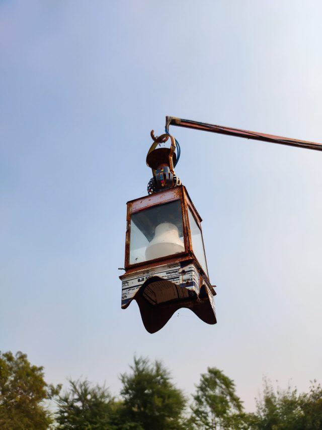Artistic lamp hanging from a pole