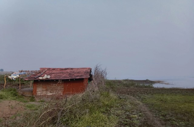 A small house near a water resource
