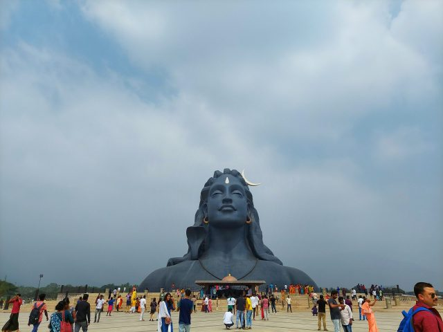 People visiting Adi yogi Lord Shiva Statue