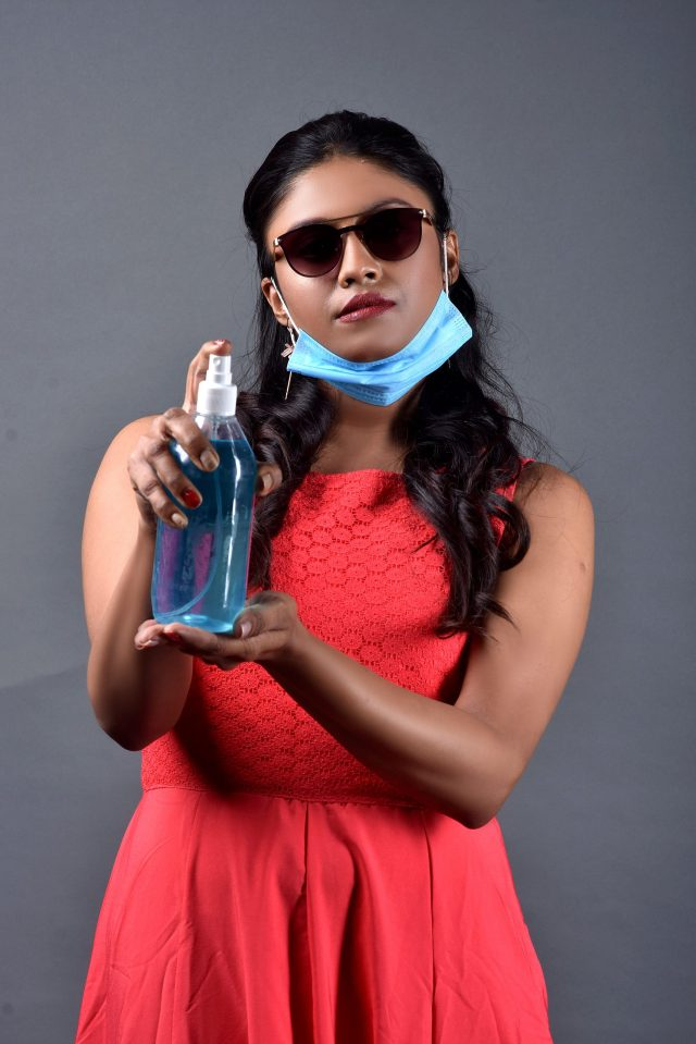 Woman with mask and sanitizer