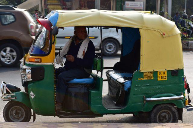 A man riding auto rickshaw