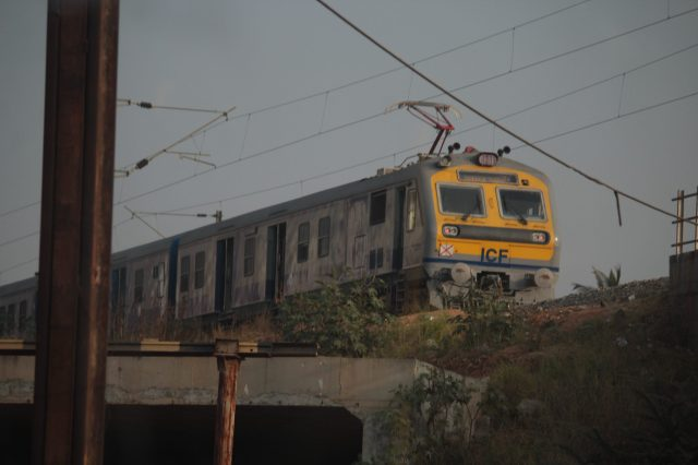 An electric train moving on a track