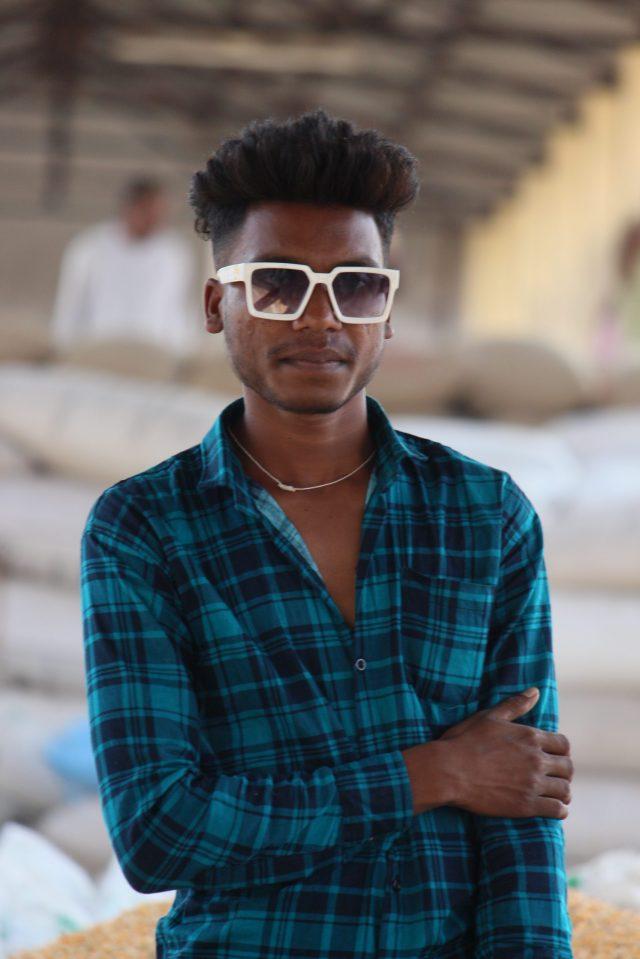Boy posing while wearing Sunglasses