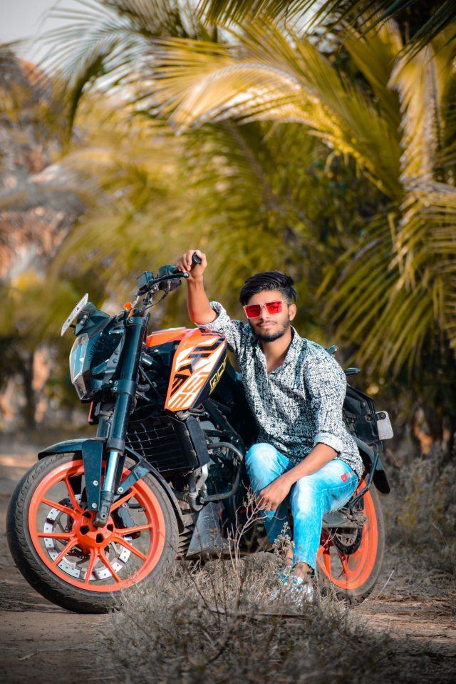 Boy posing on the Duke bike
