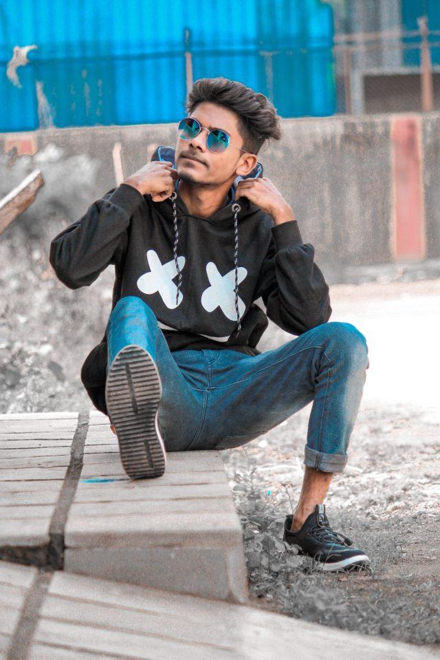 Fashionable boy posing roadside