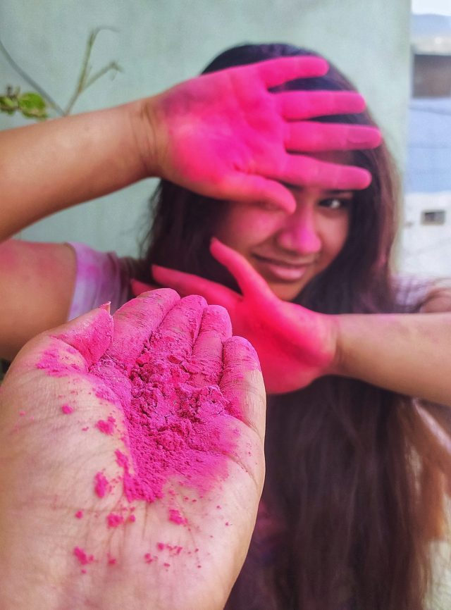 Girls' playing with Holi colors