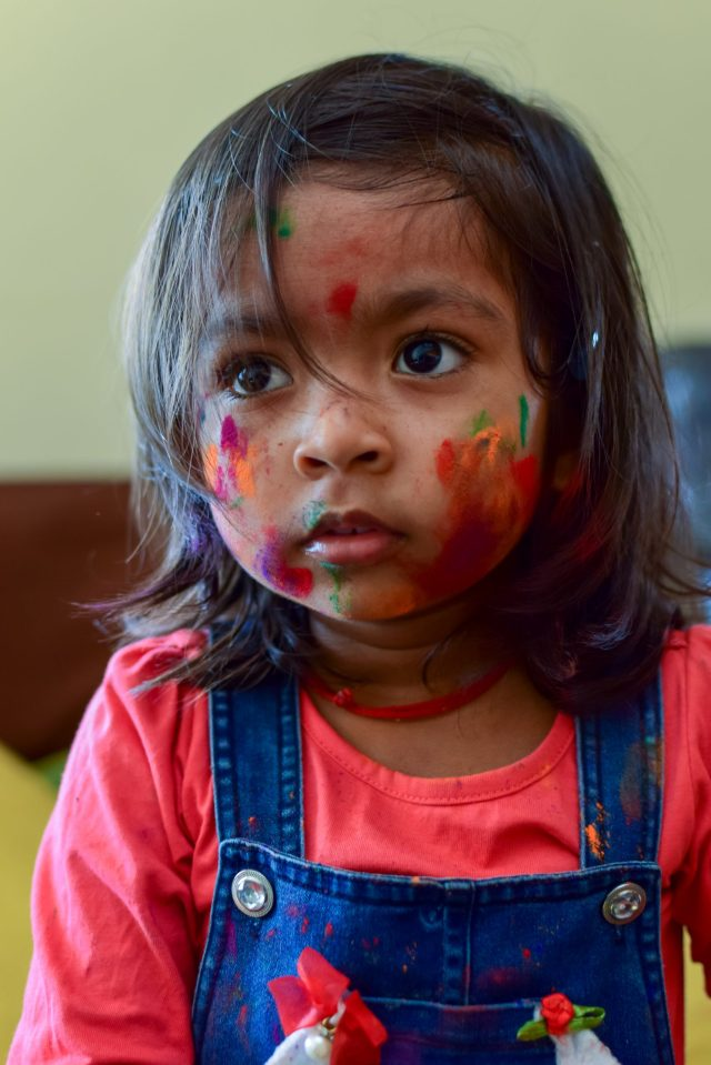 Holi colors on a child's face