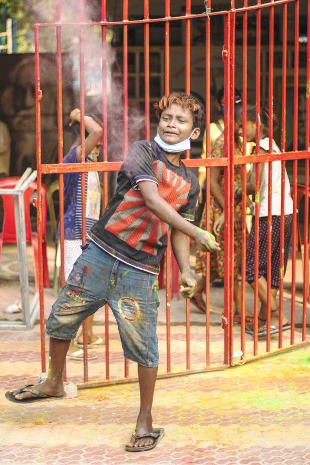 Kid celebrating Holi