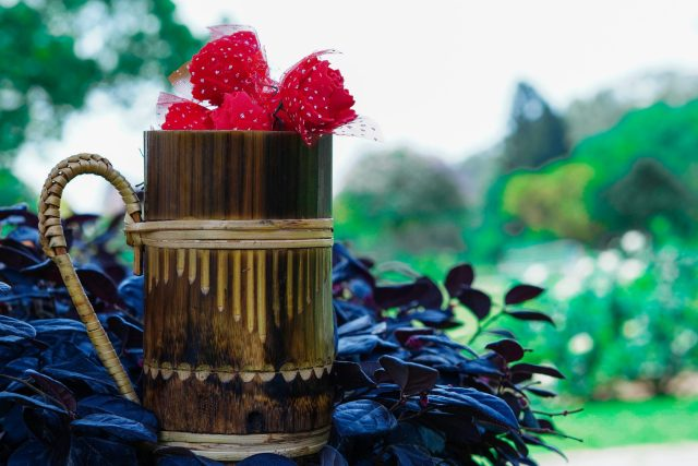 Artificial flowers in a wooden mug