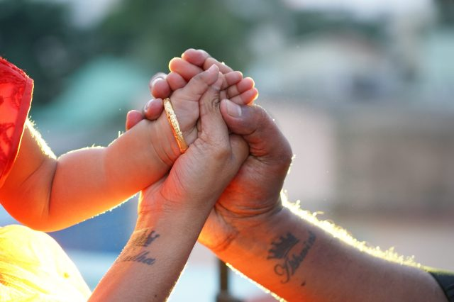 Parents and baby's hands