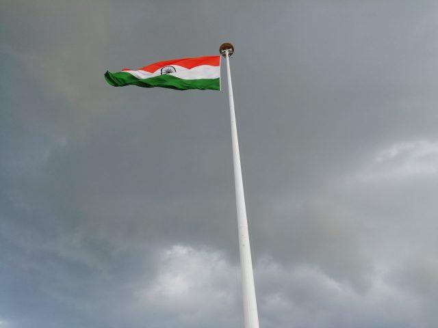 Indian flag under grey sky
