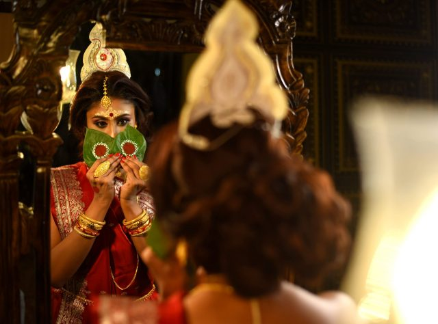 A Bengali bride with betel leaves