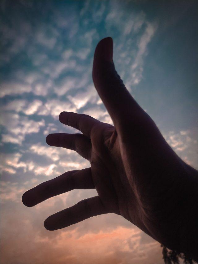 Hand towards sky