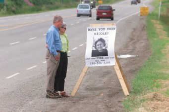 Jack and Barb Hoar of Red Deer, AB, visiting the intersection of Yellowhead 16 Hwy