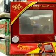 """An """"Etch A Sketch """" is for sale at FAO Schwarz in New York City on March 22, 2012. French electrician André Cassagnes created the toy in the late 1950s as the """"L'Ecran Magique,"""" and with the Ohio Art Company launched it in the US on July 12, 1960. The iconic toy has found its way to US presidential politics. Republican presidential hopeful Mitt Romney received backing from major Republican figures March 21 after a big win in Illinois, but an aide's gaffe reinforced qualms about his campaign. Asked on CNN whether the primary had pushed Romney too far to the right for general election voters, advisor Eric Fehrnstrom said """"I think you hit a reset button for the fall campaign. Everything changes."""" """"It's almost like an Etch A Sketch. You can kind of shake it up and restart all over again."""" AFP PHOTO / TIMOTHY A. CLARY (Photo credit should read TIMOTHY A. CLARY/AFP/Getty Images)"""