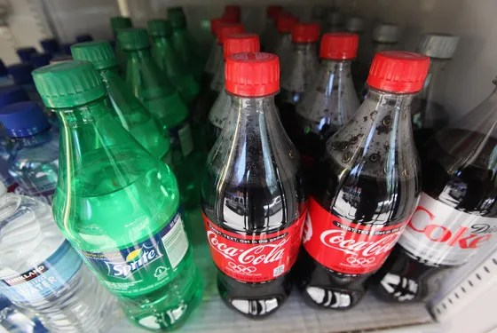NEW YORK, NY - MAY 31:  Twenty-ounce bottles of regular and diet soda are seen for sale at a Manhattan deli on May 31, 2012 in New York City. New York City Mayor Michael Bloomberg is proposing a ban on sodas and sugary drinks that are more than 16 ounces in an effort to combat obesity. Diet sodas would not be covered by the ban.  (Photo by Mario Tama/Getty Images)
