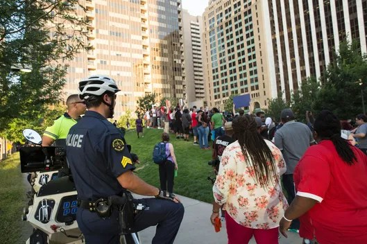 People rally in Dallas, Texas, on Thursday, July 7, 2016 to protest the deaths of Alton Sterling and Philando Castile.