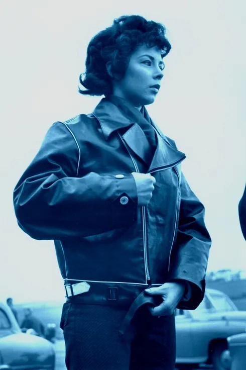 A young woman biker zipping up her leather jacket.   (Photo by Keystone Features/Getty Images)