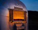 Sunset on the back window of a vintage Airstream trailer