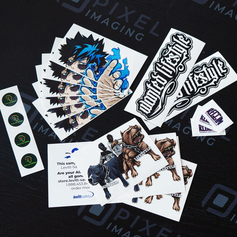 Various custom-printed and machine-cut vinyl stickers and decals. Product labels, hard hat stickers, anime vehicle decals, gangsta vinyl stickers.