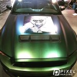 Custom-printed vinyl decal and pearlescent-green color-change vinyl wrap on a Ford Mustang car.