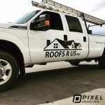Black vinyl lettering, phone number decals, and vinyl logo decals on a white Ford F350 pickup truck.