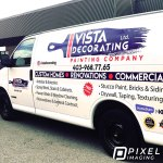 Company logo decals, vinyl lettering, and social media decals on a white company work van.