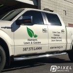 Company logo vinyl decals, phone number decals, and website URL decals on a company work truck Ford F150.