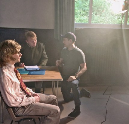 Director Ian Higgins discusses a scene with Phil Heseltine