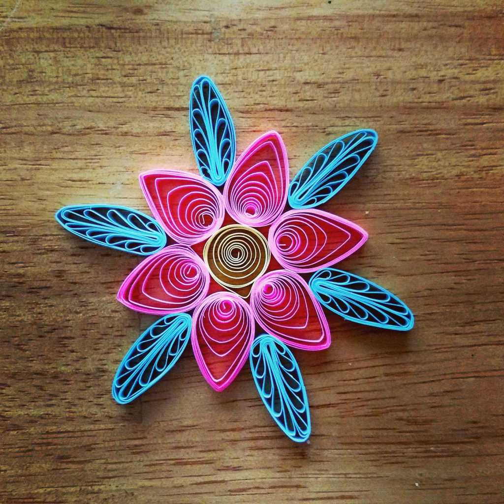 pink and blue quilled flower