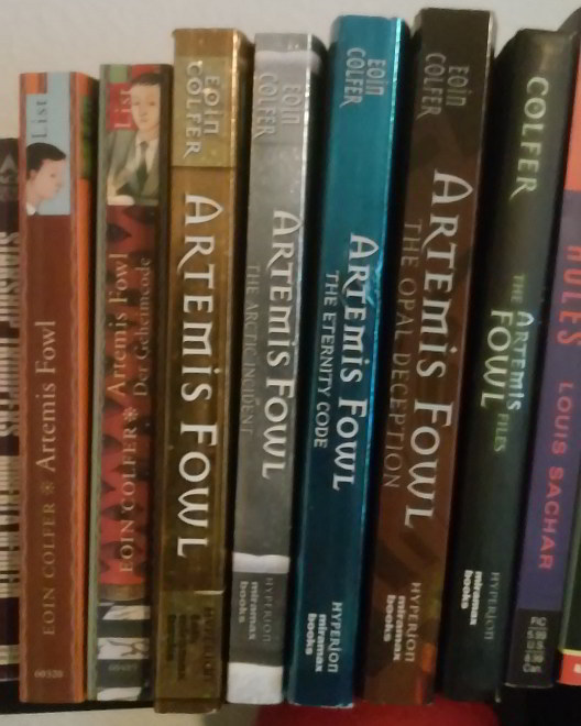 Book spines for ARTEMIS FOWL - two German editions and 5 US editions