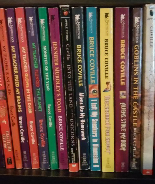 Book spines for two of Bruce Coville's alien series