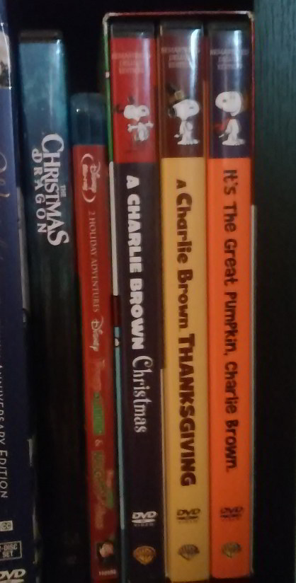 DVD spines for three PEANUTS holiday specials