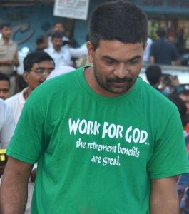 An Indian sports a t-shirt 'Work for God'